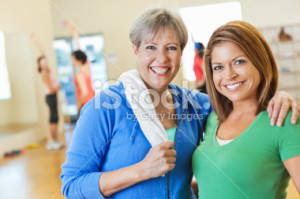stock-photo-21099068-two-happy-women-posing-in-exercise-fitness-class